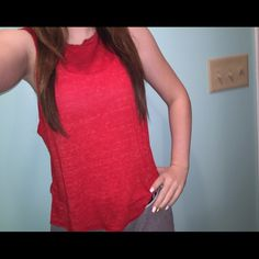 ❤️Red Forever 21 Muscle Tee Worn only a few times. Pretty think material, but not see through. It is made to look like it is cut off at the bottom, and the sides are like that too. The arm holes go down pretty far so you would have to make sure to wear a cute sports bra or bralette ! Size Small Forever 21 Tops Muscle Tees