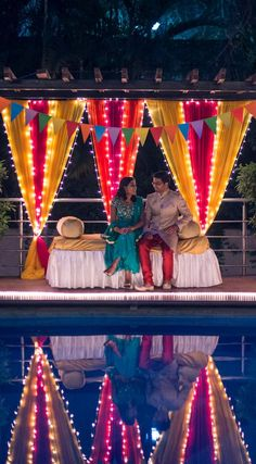 A beautifully lit evening Sangeet with décor in vibrant colors Photobooth backdrop Desi Wedding Decor, Wedding Stage Decorations, Diwali Decorations, Festival Decorations, Flower Decorations, Wedding Events, Wedding Table, Weddings, Mehendi Decor Ideas