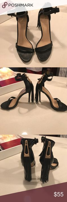 Black tassel Brian Atwood sandals Gently worn black heeled sandals. Black leather with matching tassel. Gold detailing. Thin strap around the ankle and toe. No scuffs, tears or marks B Brian Atwood Shoes Heels