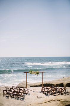Intimate beach wedding, wooden ceremony arbor, florals // Shane & Lauren Photography