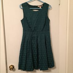 Green Cutout Flare Dress Perfect for the holidays, date night, or work! The shell is cotton/poly/spandex and the lining is 100% polyester. Zipper in the back and two buttons above the cutout. Follow me on Instagram: @vicariouskatie Forever 21 Dresses