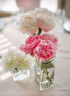 I like the idea of have three small vases of flowers at different heights. ( peonies)