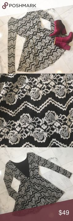 """•new• NWOT """"Chimera"""" backless lace skater dress Lined black and white lace skater dress with sheer lace sleeves. Open back with nonfunctional tie behind the waist. (Booties not for sale) Boutique Dresses Backless"""