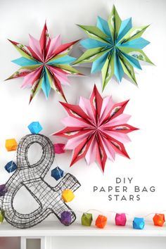 OR use printed paper (http://lorajeansmagazine.blogspot.ca/2008/04/paper-bag-flower-from-scratch.html) and/or add cut outs to make them look like snowflakes!