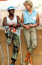 January 14, 1997: Diana, Princess of Wales talks with victims in Angola at an orthopedic center outside Luanda. Angola is one of the world's most heavily-mined countries.