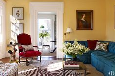 In the living room, painted in a Farrow & Ball Orangerie, an ancestral portrait overlooks a Harry Heissmann–designed banquette made by De Angelis and covered in a Brunschwig & Fils fabric.