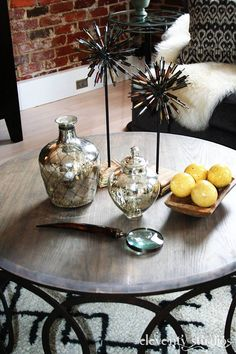 Vignette of Cocktail Table. Love the Firework's Sculpture...Small details such as accessories like these, make the room come to life and Give it personality Interior Design by Michelle Vittetoe for Stacie and Keebler Williams.  Photography by Holly King-Welch of Eleventy Studio's.
