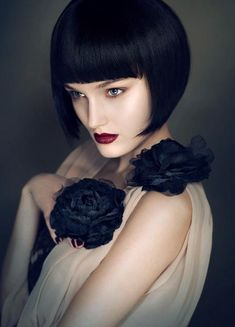 Love her jet black hair,  red lips and black roses.