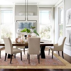 Love the gray walls with dark dining tables and linen chairs.  Navarro Extendable Dining Table | Williams Sonoma Home