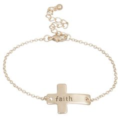 "Heirloom Finds Faith Sideways Cross Bracelet in Lovely Matte Gold Tone. Bracelet measures 7"" long with a 2.5"" extender. Sideways crosses are a trendy style. Stamped with word ""faith"". Inspirational jewelry. Makes a great gift! Arrives gift boxed!."