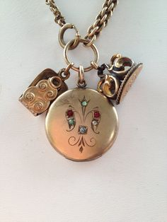 Antique watch fob necklace with round locket - Neat way to use those old watch items from your grandparents - making a unique jewelry item for you!!