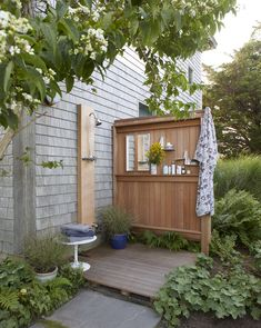 "A Modest Beach Cottage on Martha's Vineyard Goes from ""Bad Seventies"" to ""Good Seventies"" The outdoor shower is just outside the master bath, but it's accessed off the front porch. Beach House Style, Beach Cottage Style, Beach Cottage Decor, Coastal Style, Surf Shack, Beach Shack, Bungalows, Outdoor Bathrooms, Outdoor Showers"