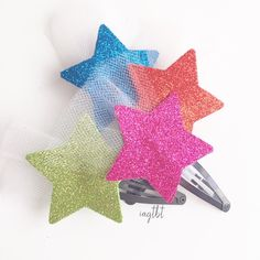 So+unique,+whimsical,+the+Shooting+Glitter+Star+Hair+Snap+Clips,+are+so+magical⭐️  These+little+beauties+are+made+with+Glitter+Foam+which+made+this+clip+so+soft+but+yet+durable,+and+it+is+adorned+with+white+tulle+and+adhered+to+a+black+snap+clips.+  Come+in+4+different+colors  These+clips...