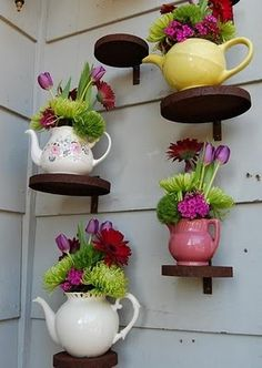 Love these teapots for planters! Good to use teapots that have lost their lids!