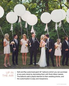 """Kelli and Rej customized giant 30"""" balloons (which you can purchase at any party store) by decorating them with floral-ribbon tassels."""
