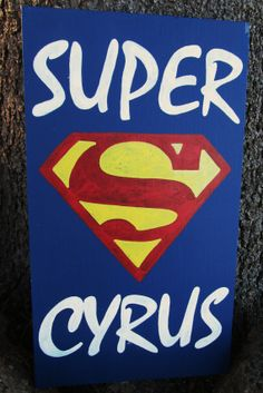 "This super sign is sure to make any super-boy or girl in your life smile! Place as an accent piece for your child's room, or give this sign as an excellent, unique birthday gift! Choose between a pink or blue background. Lettering is white, and the super-symbol is red and yellow. Message me your child's name in the comments with your order. Approximately 18"" x 10"""