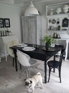 black table and chairs in an white kitchen
