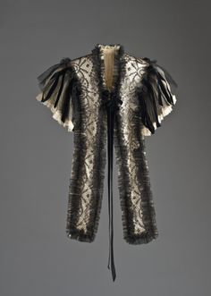 Woman's Mantelet by Henriette Favre (France, Paris, active early 20th century) France, Paris, circa 1902 Cotton lace, silk chiffon, silk velvet ribbon, and sequins (59.68.9) | LACMA Collections