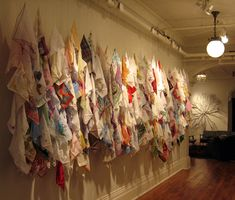 Snot & Tears (Crjetha Meyer's collection of 1000 handkerchiefs)  Hazel Meyers Several handkerchiefs are attached to a pivoting coil that raises or lowers them smoothly, hypnotically, and slowly enough to startle when caught in the corner of the eye