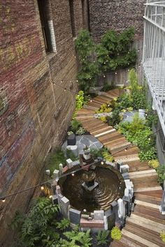 The Hummingbird Garden, designed and built by Organic Mechanics, is nestled between two old high-story brick buildings, behind the Mark Twai...