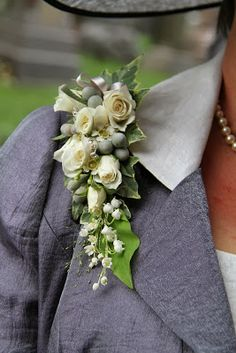 The Bride Groom's Mum looked fabulous and her corsage matched her silver, pewter and ivory ensemble perfectly