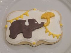 Vintage baby shower cookies  Elephant, umbrella, bunting Made by: icakepops
