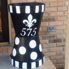 Address pots I painted for my porch