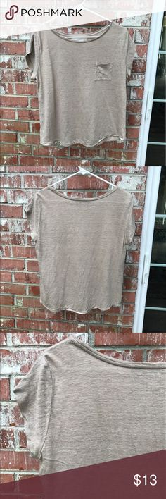 """LOFT Tan Linen Top 100% Linen. Tan with some simmer. Small pocket. Not stiff but relatively flowy. Last pic shows color best & not as worn as appearing in pics. MP but runs like a M-PL. 21"""" pit to pit, 24"""" long. Worn mostly with the denim light wash mermaid skirt in my closet. Always gently washed and line dried. In great condition. LOFT Tops Blouses"""