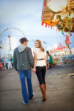 love the looking over shoulder with the carnival in the background! Our first date as a couple was at the fair!