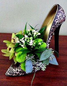 Ceramic shoe floral arrangement created by a talented Grower Direct florist.