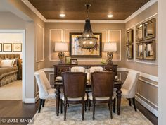 Traditional Dining Room With Hardwood Floors Pendant Light Crown Molding High Ceiling