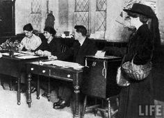 Woman recording her vote in first election in which women were allowed to vote. Location: United Kingdom Date taken: October 1918