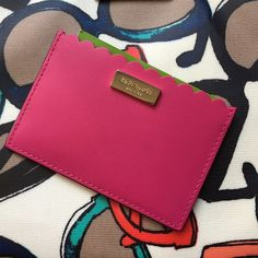 Brand New Kate Spade Card Holder Wallet Open slip pocket at top 3 card slots on the back Leather card holder with gold tone hardware and logo Approx. dimensions: 4.25 in L x 3 in H x 0.25 in W at the base kate spade Bags Wallets