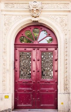 Sangria color door...I absolutely love unique and inviting doors, my dream homes will have them throughout...one of the definite reasons I long for European travels!!