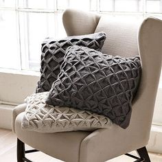 I love the Sculpted Origami Pillow Cover for the man room couch. These are really cute and add a lot of texture to a smooth area like a leather or smooth upholstered chair/couch