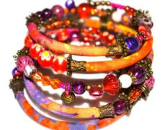 Orange, purple, pink and bronze adjustable wrap bracelet with glass and handmade fabric beads on memory wire