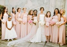 Tamera's Mowry's bridesmaids dressed in light pink dresses of the same shade, but carried pink roses of varying shades