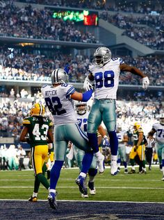 Tight end Jason Witten #82 celebrates a touchdown with wide receiver Dez Bryant #88 of the Dallas Cowboys against the Green Bay Packers in the first quarter during a game at AT&T Stadium on December 15, 2013 in Arlington, Texas.