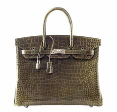 This Hermes Birkin in size 35 is coveted worldwide. Featured in the hot Vert Veronese color, this Birkin is absolutely gorgeous.