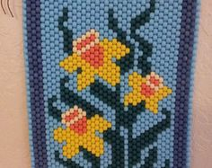LISTO para nave Amaryllis amarillo flor abalorios bandera