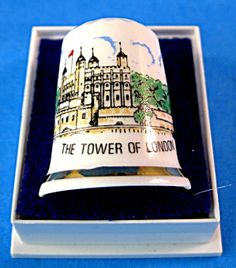 This is an English bone china thimble in it's original fitted box with a picture of the Tower Of London, England with gold trim. The thimble measures 1.15 inches high by .95 inch in diameter, was made in England in the 1970s and is in excellent, mint condition.