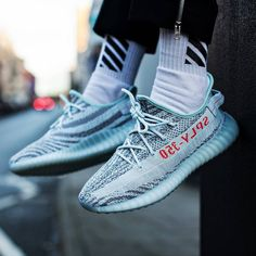 1f399708e3f Adidas gave us a great looking Yeezy. This time using hints of grey over a  light baby blue with infrared accents. The Yeezy Boost 350 features a  tinted blue ...