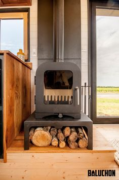 This tiny wood stove keeps the Intrépide tiny home warm during the winter.