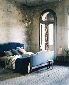 blue bed, chandelier