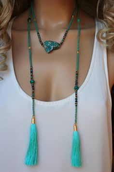 This lovely piece has pretty green/turquoise color of faceted glass(tiny-3-4mm) beads,gold plated spacer beads,natural variscite and few gemstones. Finished also silk tassels with gold plated caps. This happy Statement layering necklace is perfect for any situation.you can wear