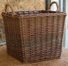 """The Square Willow Bin Basket is perfect for keeping extra pillows, blankets and other everyday necessities neatly stored. A versatile and attractive complement to any room. 16"""" x 16"""" x 14"""" tall"""