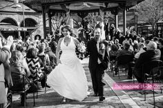 JUST MARRIED! Outdoor ceremony site during a Spring Wedding at Two Brothers Roundhouse in Aurora. Photographed by The Wedding Studio, Schaumburg IL