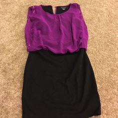 Forever 21 dress Purple top that is loose fitting. Black bottom part that is very form fitting Forever 21 Dresses Mini