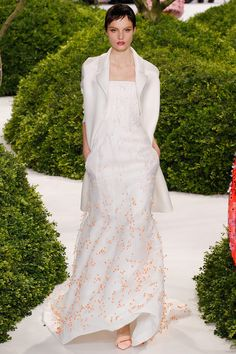 Long white jacket over white beaded gown; delicate orange beading at the bottom -- Christian Dior, Spring 2013 Couture