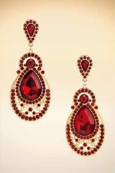 The faceted ruby colored stones illuminate these earrings. So dazzling, you'll want to pair them with every wardrobe piece this holiday season.